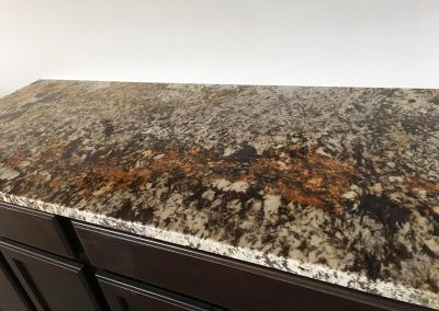 Custom cabinetry with custom natural stone granite countertop by Gordon Creek Granite of Hicksville, Ohio.