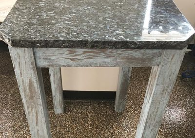 Wood table with custom natural stone top by Gordon Creek Granite of Hicksville, Ohio.